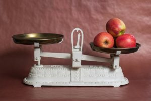 A scale with Apples