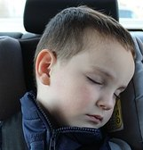 Child sleeping in car