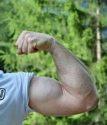 man flexing biceps and triceps muscles